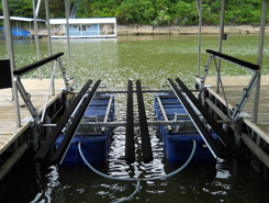 photo of a classic model Tritoon Boat lift